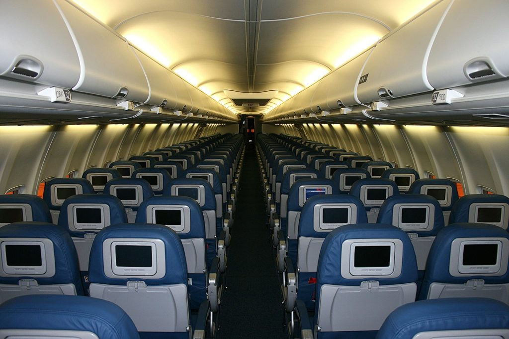 reduce the environmental impact of flying with flying economy class